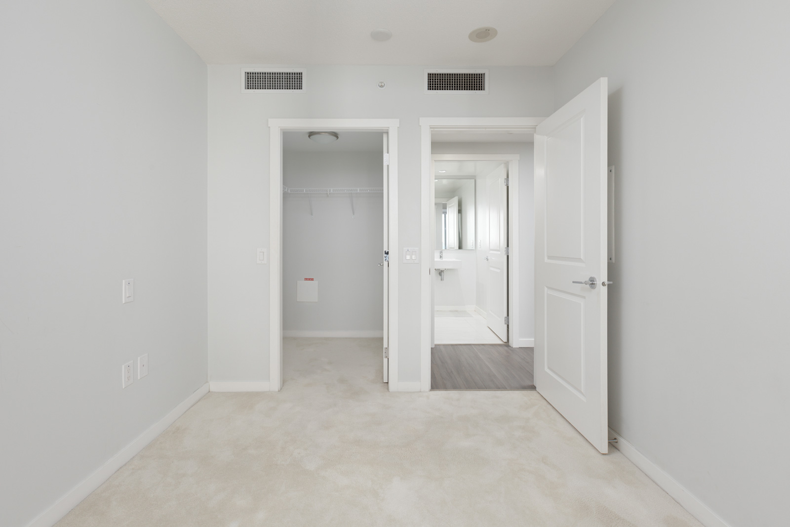 view from the inside of the bedroom with door and closet