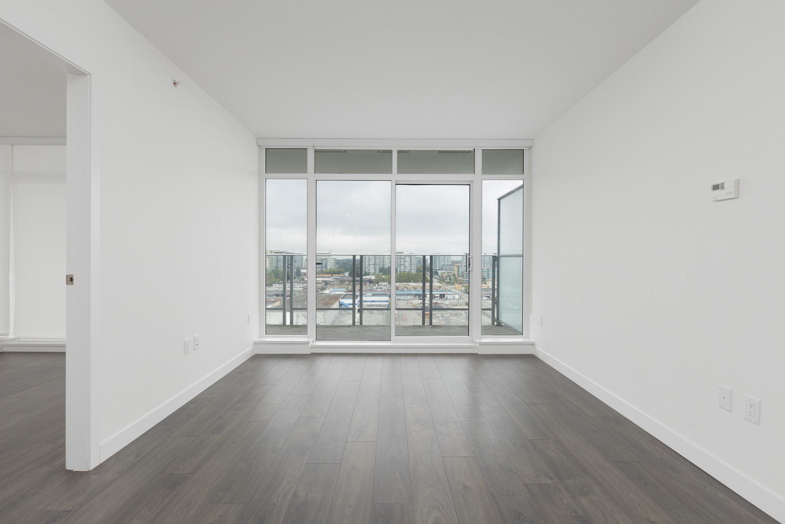 Cozy living with hardwood in furnished Orchid Building on the 13th floor