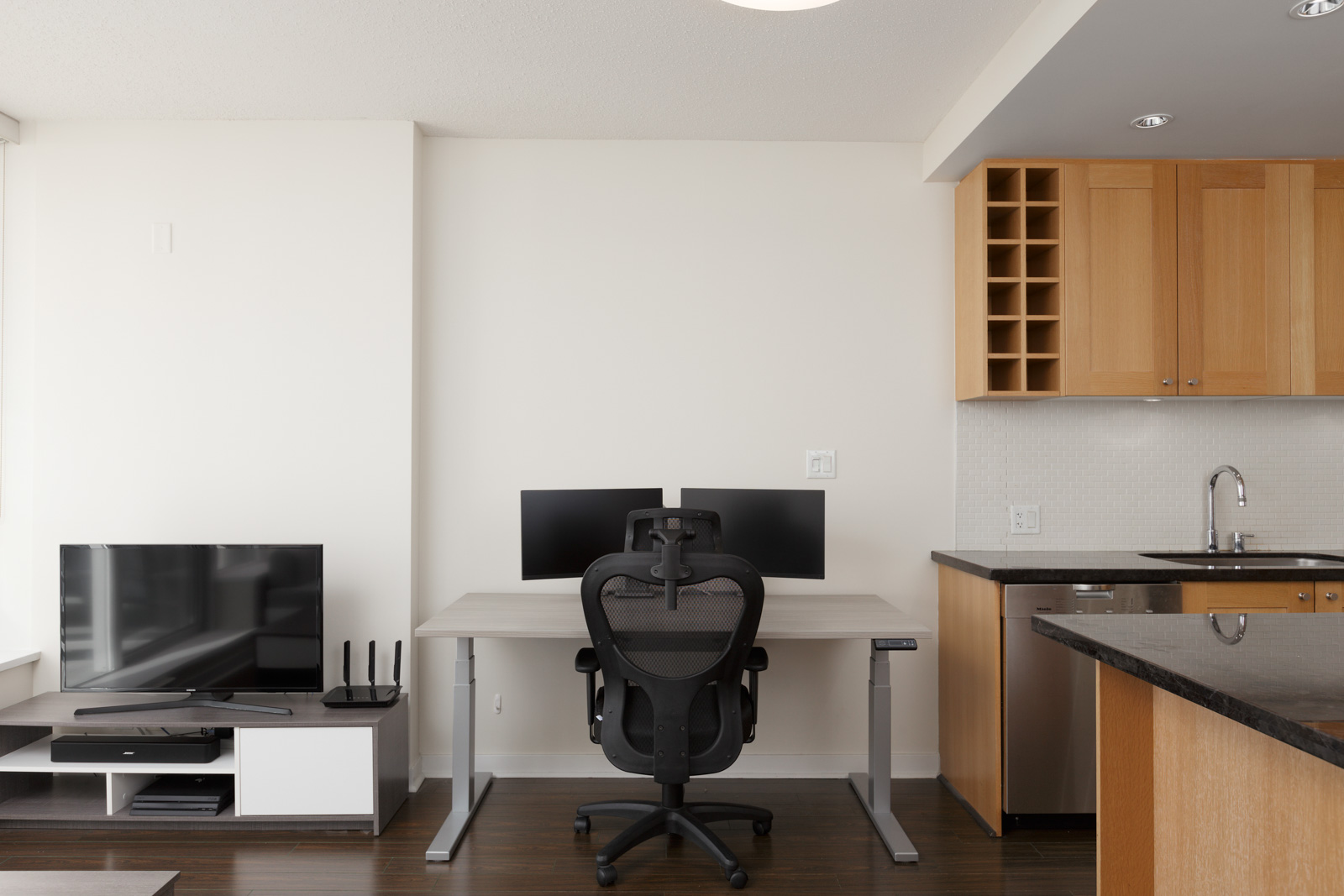Home office next to a kitchen furnished Yaletown condo
