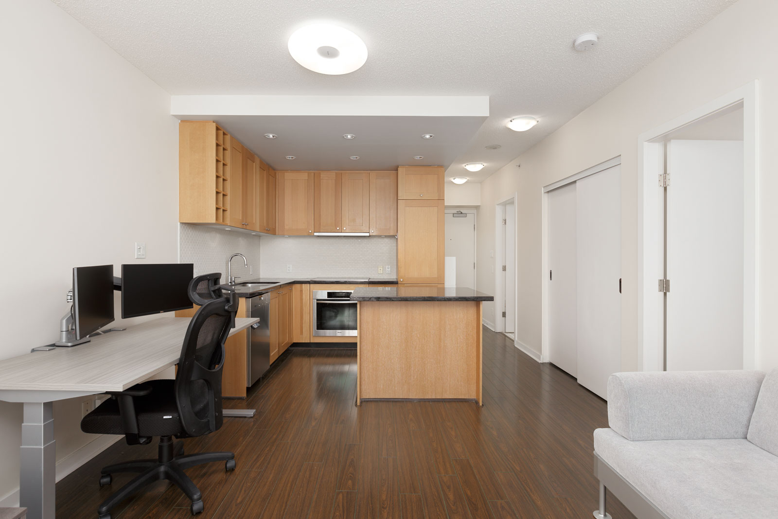 Modern kitchen with home office desk inside Yaletown condo