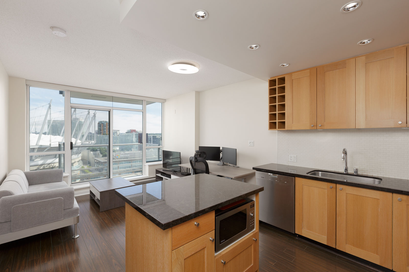 View of kitchen and dining room inside upscale Yaletown condo