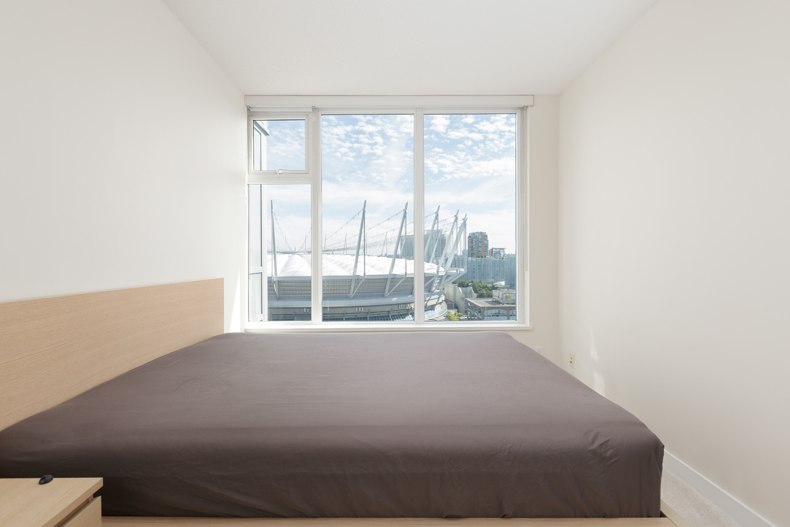 Bedroom inside Yaletown condo with view of BC place
