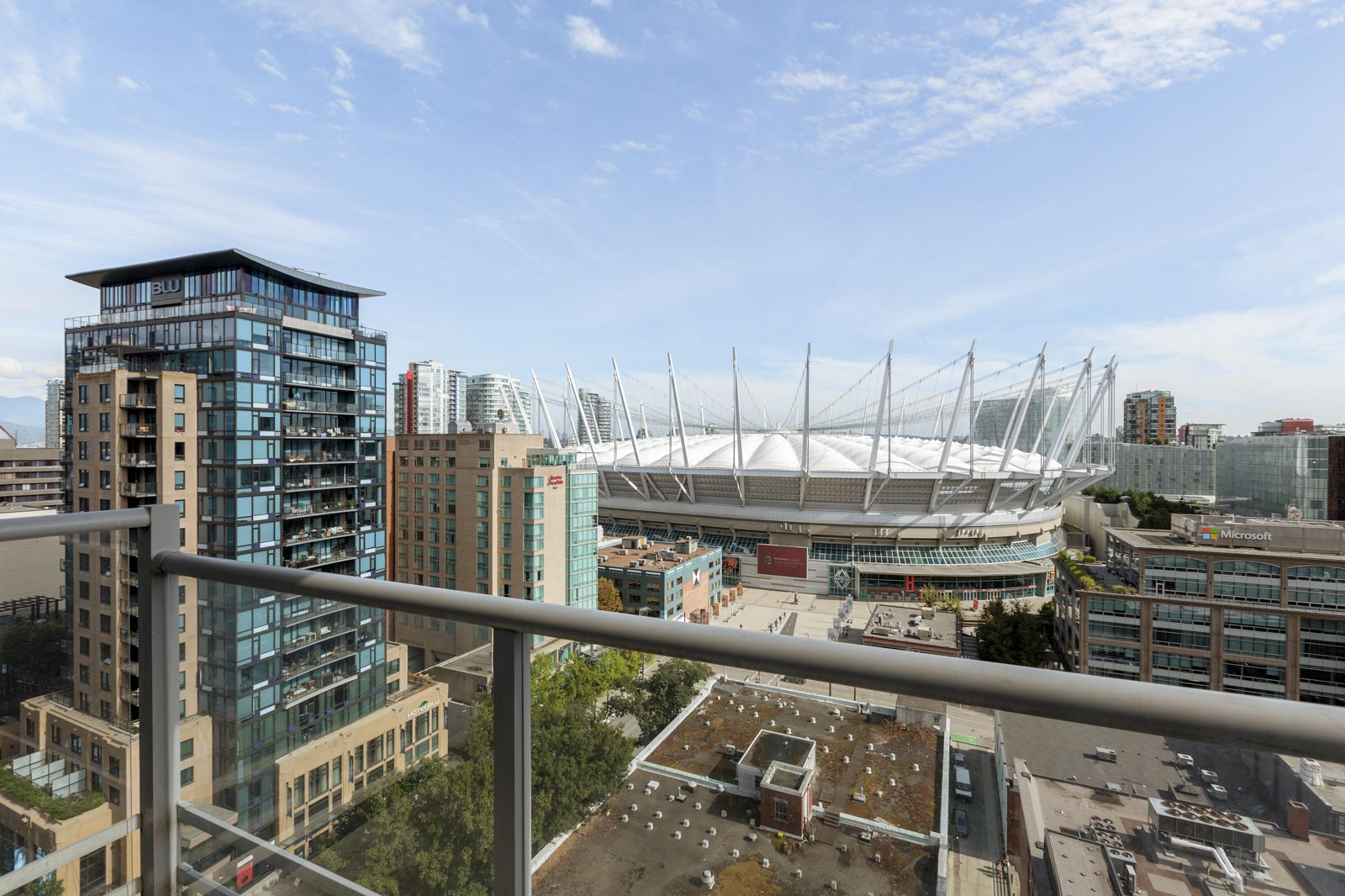 Balcony view of downtown Vancouver with BC Place in background