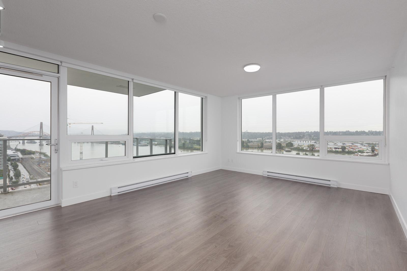 laminate floors and big windows in a modern condo in new Westminster