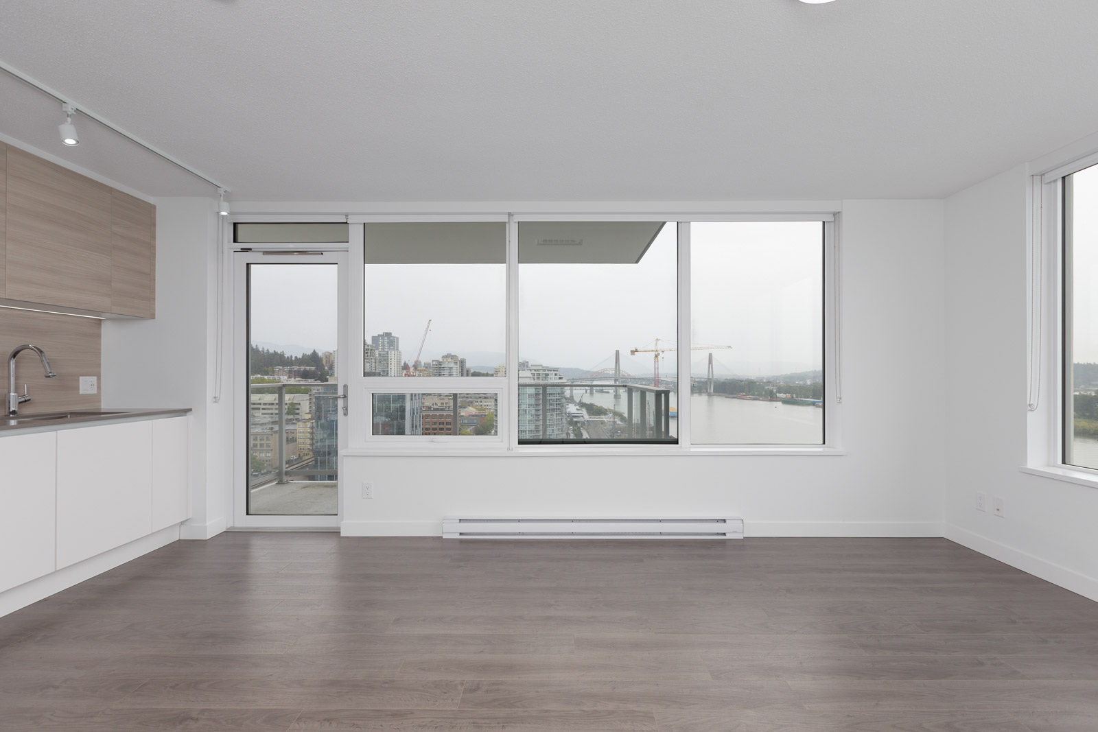 laminate floors and door to the balcony and big windows