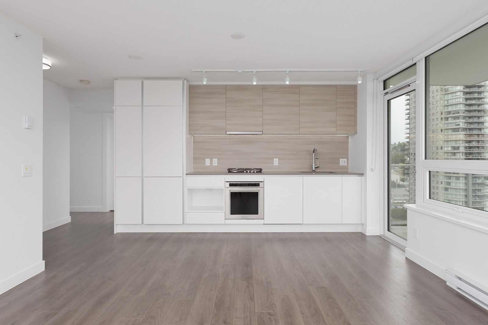 open concept white kitchen in a modern condo in new westminster