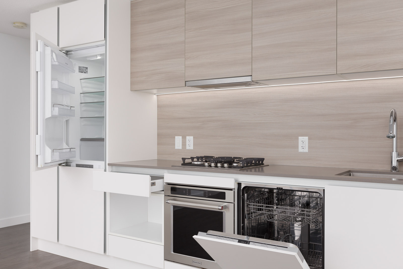 open dishwasher in a white kitchen in a wood parts