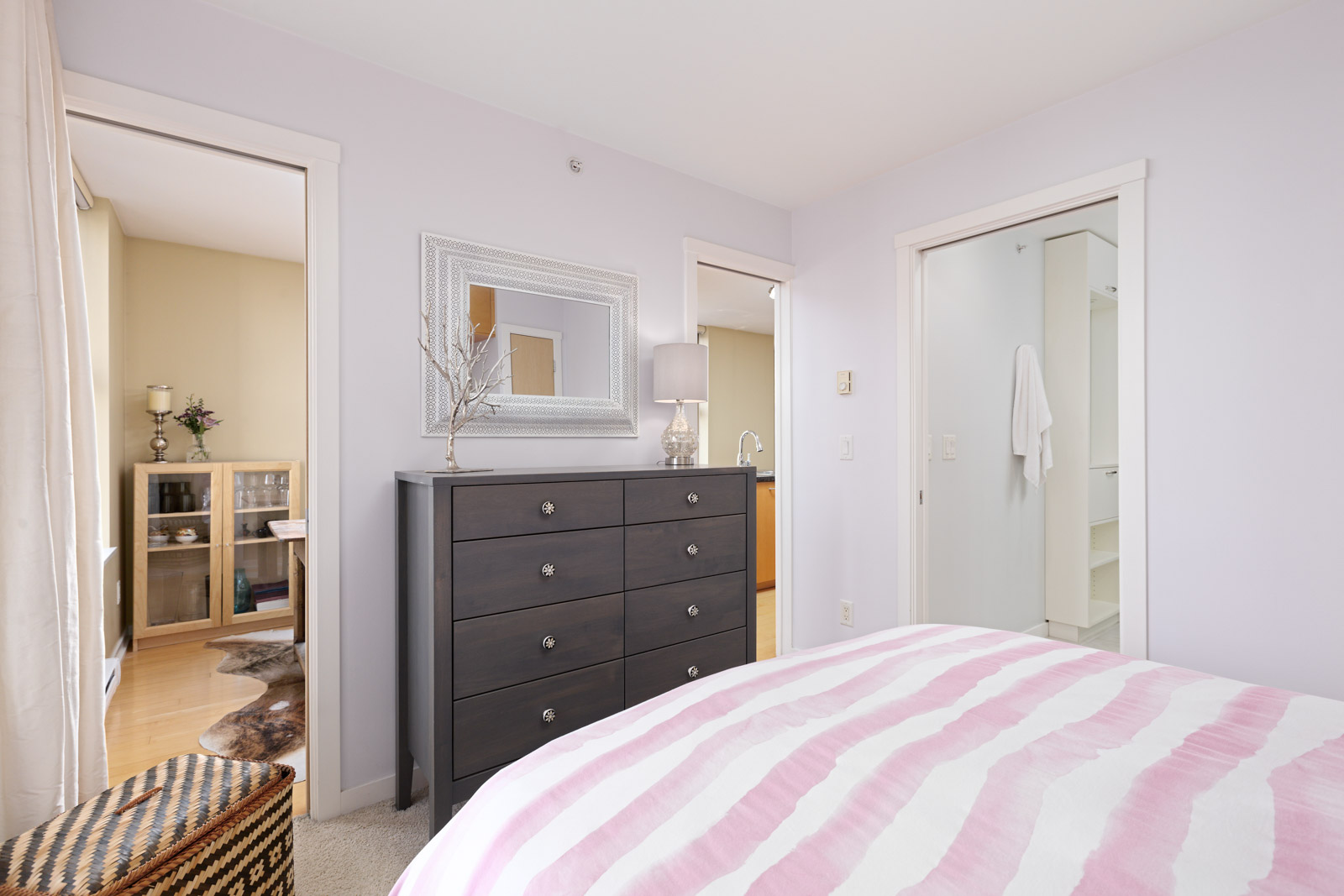 furnished bedroom in Yaletown condo with pink bedding