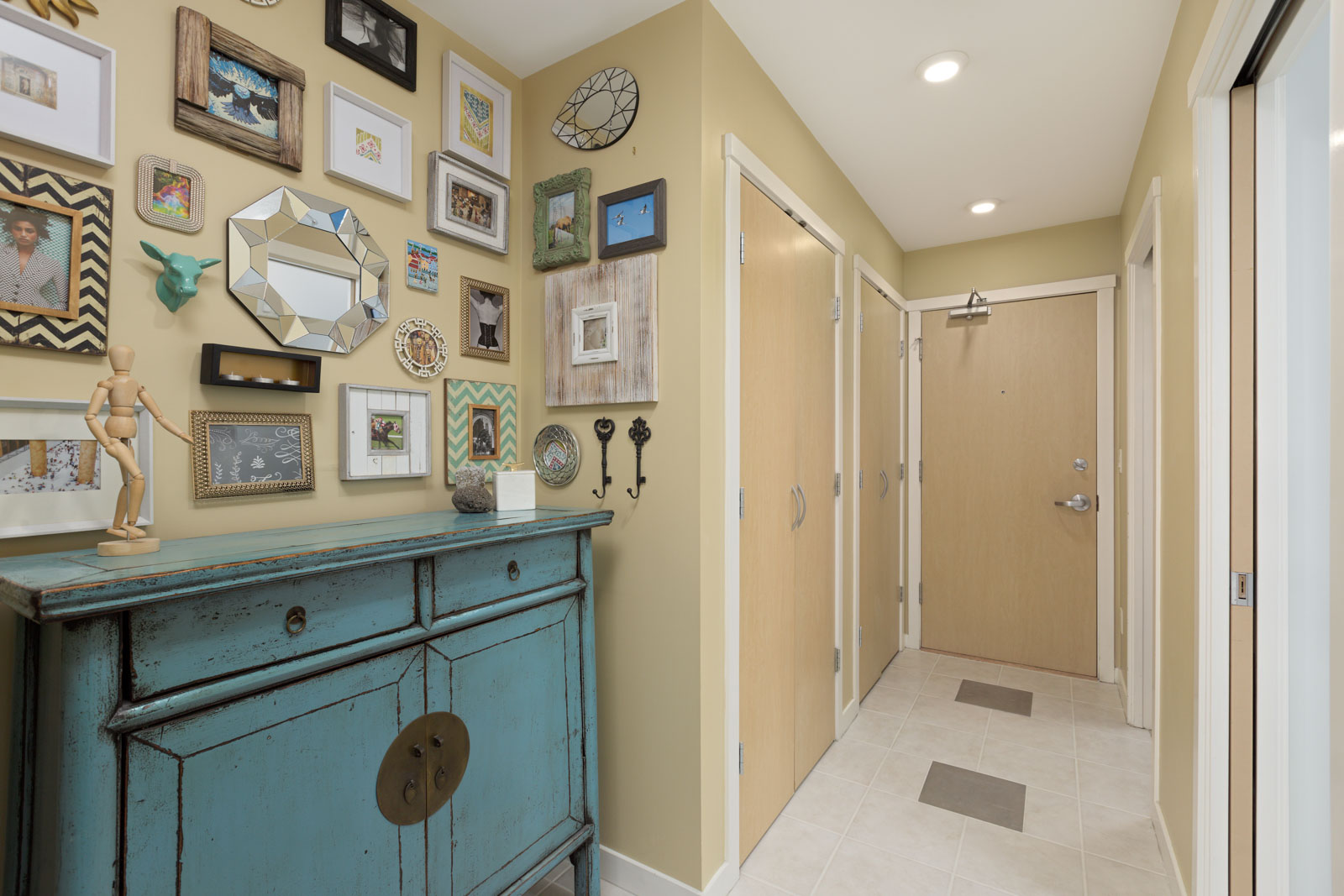 furnished hallway in upscale Yaletown Vancouver condo with nautical dresser